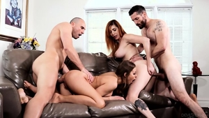 Erotic brunette enjoys greatly orgy