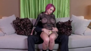 Sex scene accompanied by large tits redhead