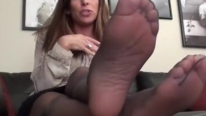 Female in tight stockings feet licking solo